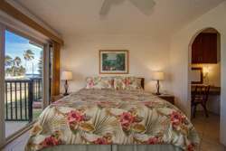 large bedroom with king bed and glass door to lanai - click for larger picture